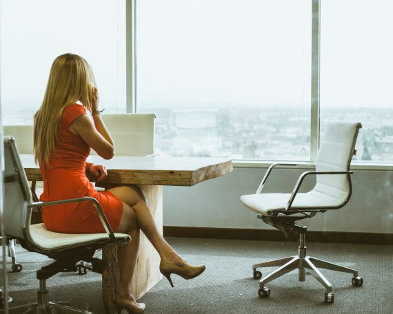 woman in conference room on telephone